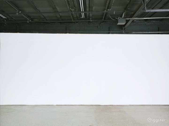Flat Wall: Our most versatile tool: a 24' x 10' flat wall primed for paint, wallpaper, and everything else you need for the sets you dream up. Also includes two full-size duvetyne curtains for easy access to an infinite black background.