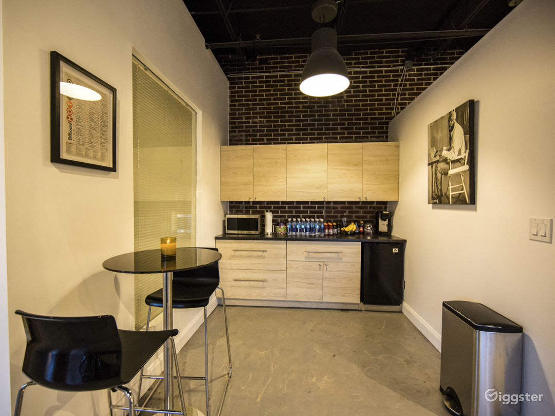 Kitchenette Area With Microwave and Mini Fridge.