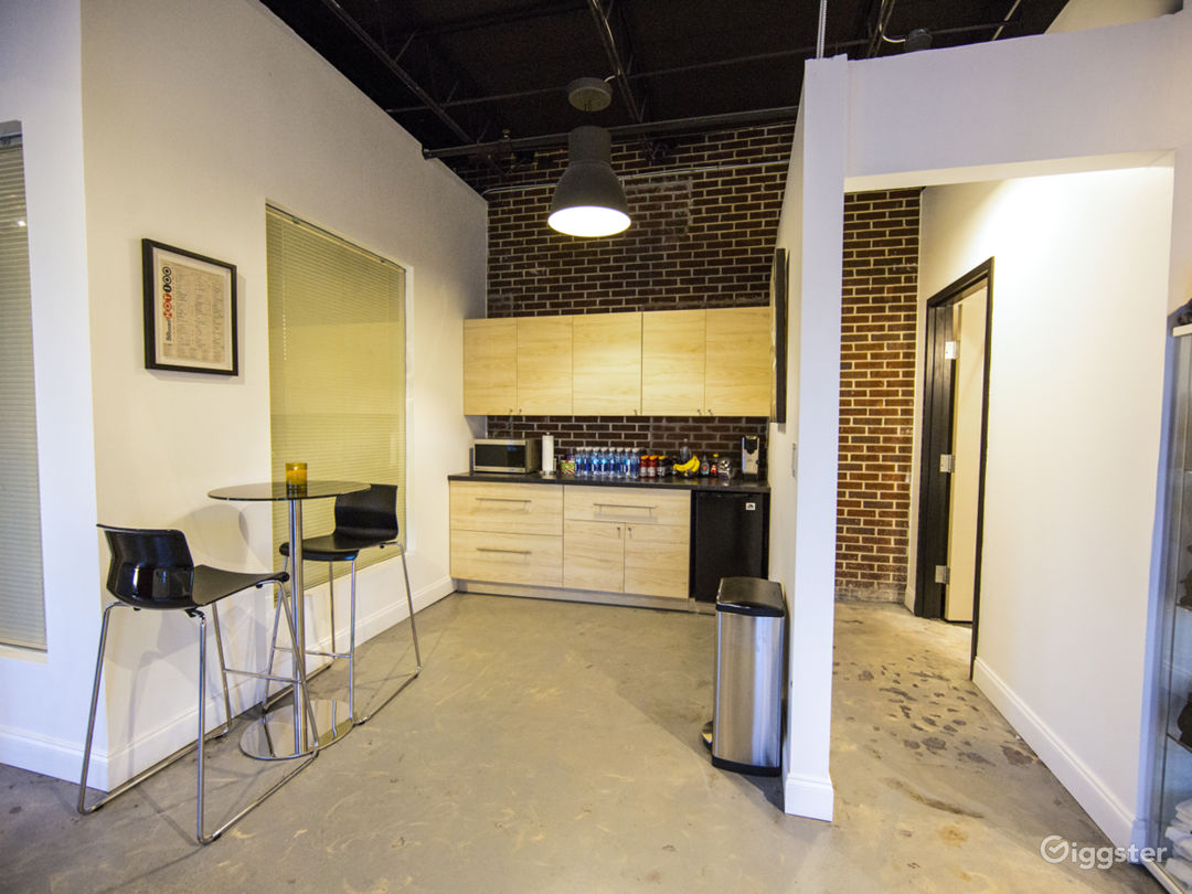 Second Angle Of Kitchenette Area With Microwave and Mini Fridge.