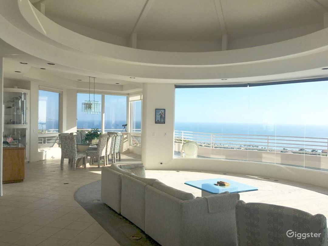 Living room and dining room with panoramic ocean view and direct access to wrap around front deck.