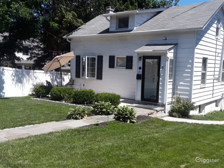 Small cozy Cape Cod with front porch and treeline gate in backyard