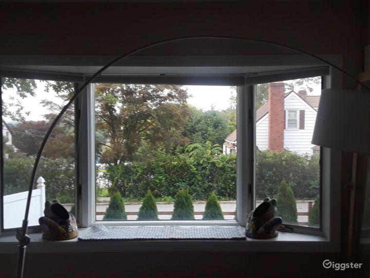 Bay window room is empty with closet. Window shows backyard. Door leading to backyard.