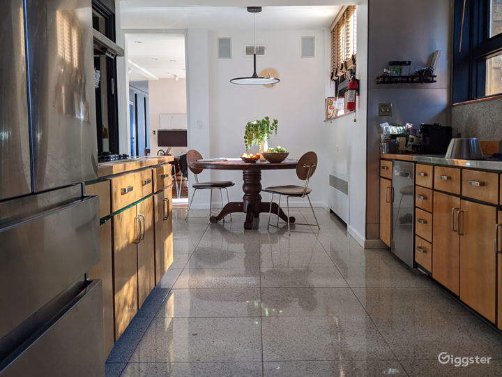 Original mid century galley kitchen with cabinetry and terrazzo floor.
