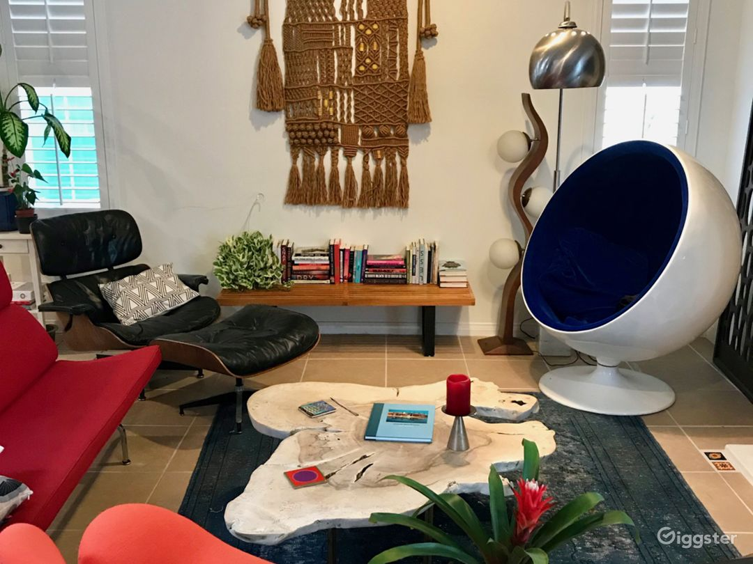 Living Room -- Eames sofa and Chaise Lounge, 70s macrame, Arno ball chair, Mexican Yucca wood coffee table,George Nelson slat table