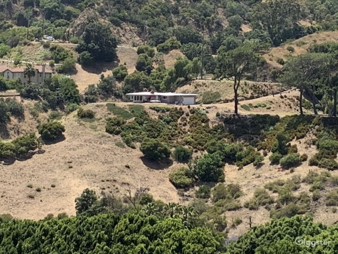 entire hill-full frontage-3.5 acres with two flat pads and home epic views