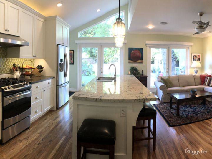 Kitchen/Family Room with French doors leading out to back garden