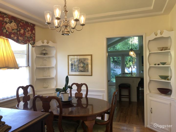 Traditional dining room with built-in corner shelves