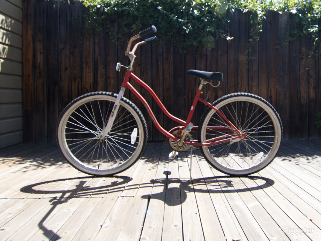Beach cruiser bicycle parked on back deck.