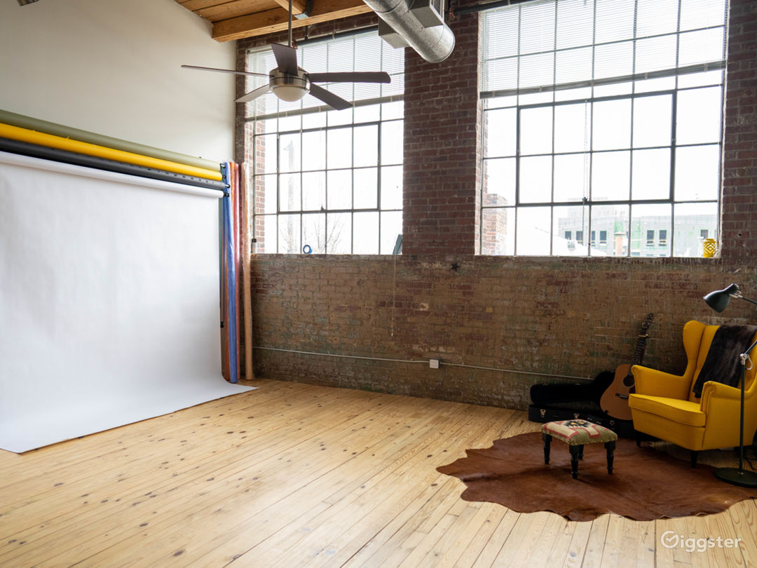 Industrial Exposed Brick Studio Loft with Lights Photo 1