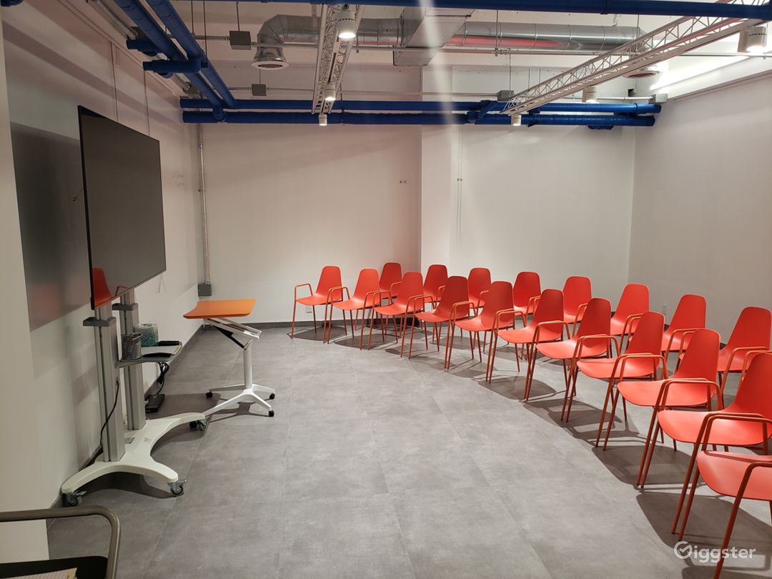 Flexible space - setup without tables. Large screen TV available to hook up with PC or Mac.