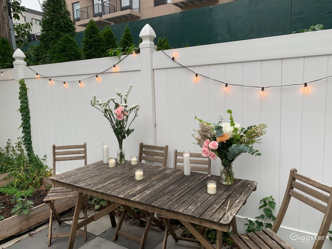 Outdoor table with floral arrangements for food
