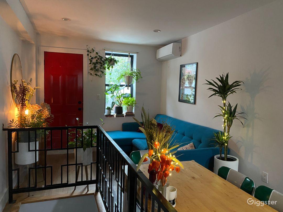 Plant-filled living room/kitchen