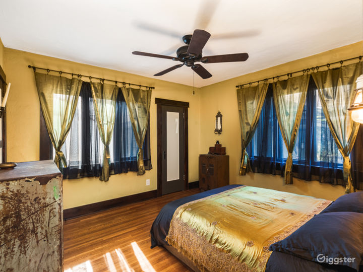 Master Bedroom with Indian silk drapes and Industrial-chic armoires