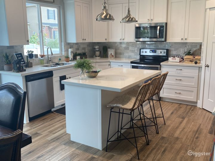 White kitchen with stainless steel appliances.