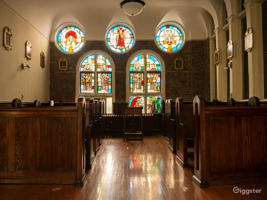 Beautiful stained glass windows filter natural light into the downton manhattan holy chapel.