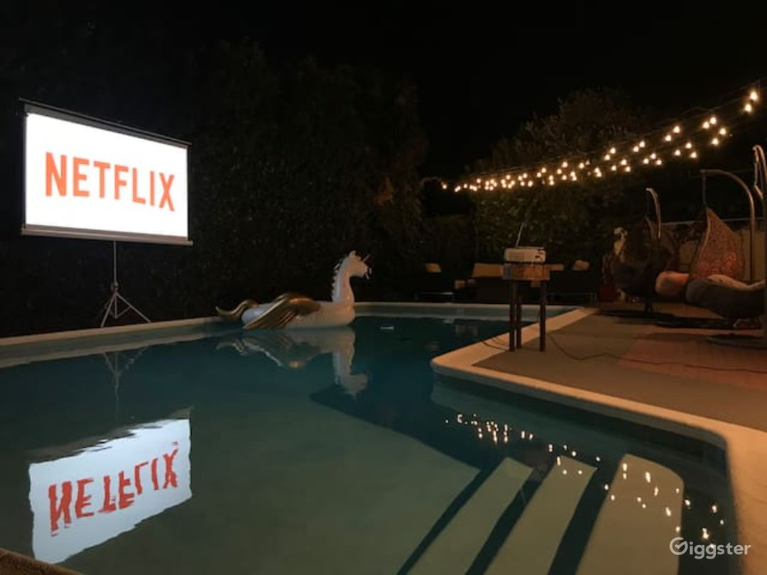 Back Pool Area At Night With Moveable Projector Screen