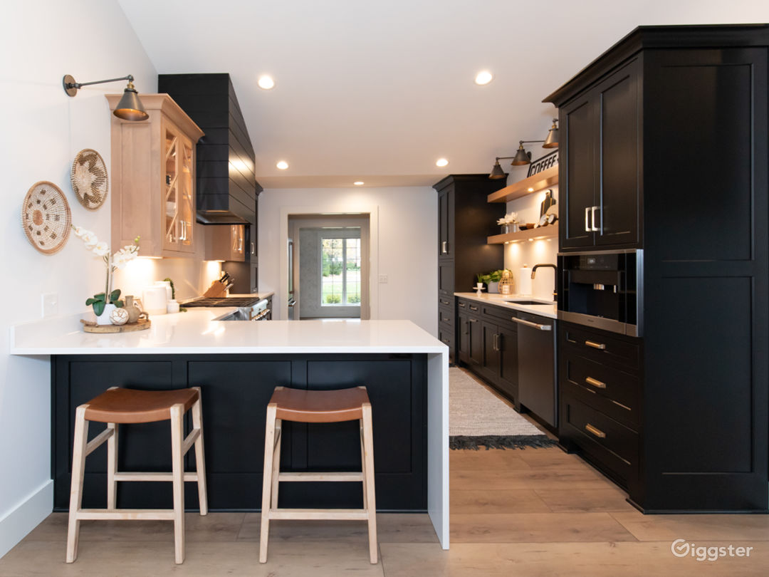Black kitchen cabinets with  quartz counters