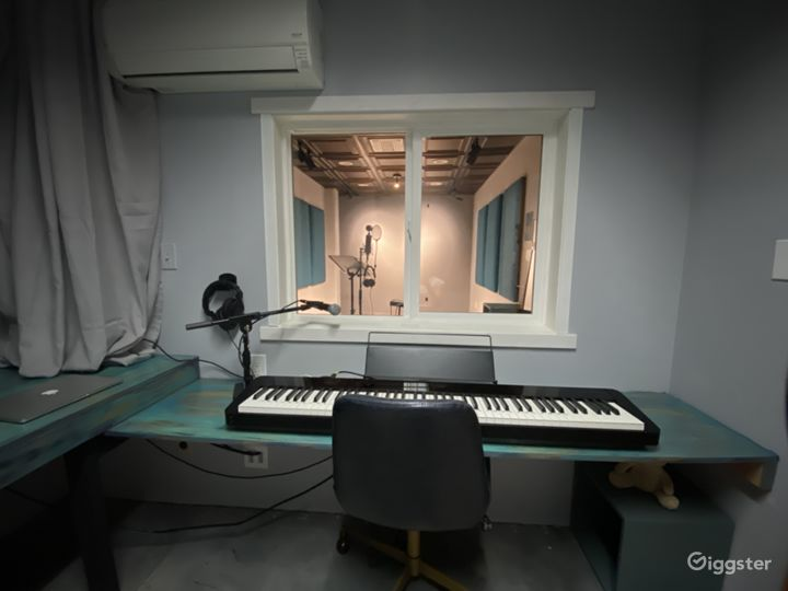 Audio Room - Works as an engineering space with the ability to work through a two way mic system into the Recording Room for recording or coaching.
