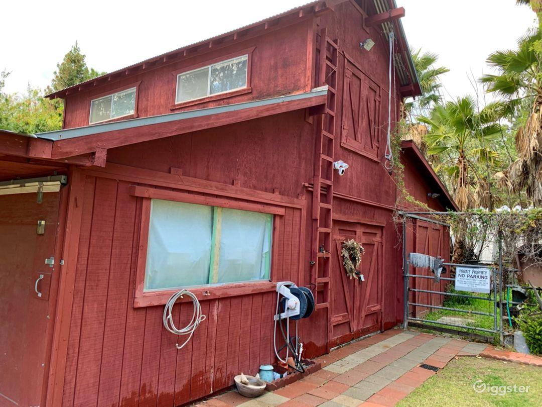 Main entrance faces east.  Double door hay loft.