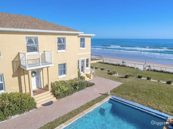 Relaxing Outdoor Pool and Garden at Ormond Beach Photo 4