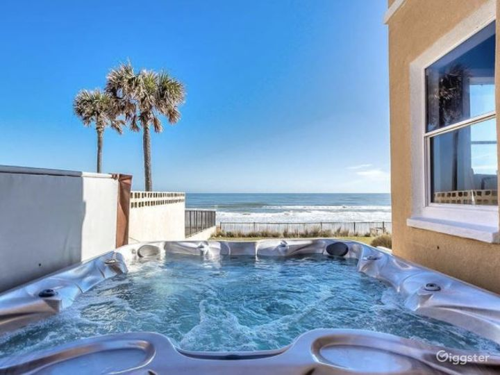 Relaxing Outdoor Pool and Garden at Ormond Beach Photo 2