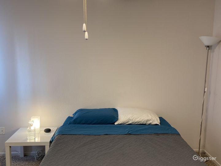 Master bedroom queen bed.