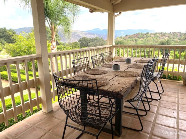 Loggia/veranda has views of the pool and orchard. Cool and serene, the loggia wraps around the back of the home with access to kitchen and 2 beds/2 baths
