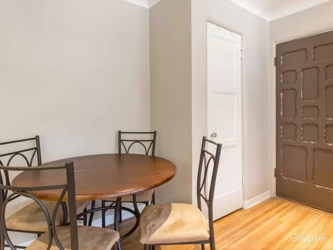 Entrance way with 4 person dining room table, clothes closet (w/ iron and board inside)