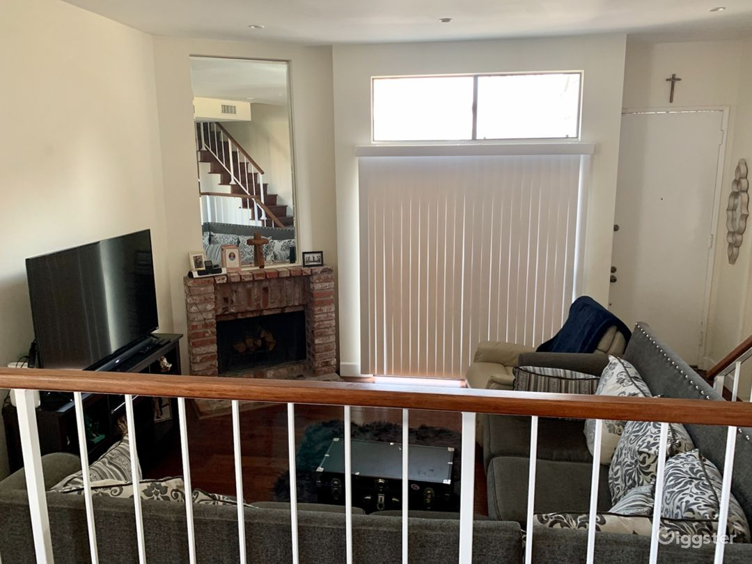 Den area with ample sitting space and fire place.