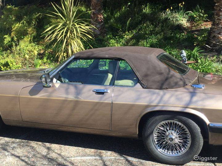1990 XJ12 Gold Jaguar Convertible, brown soft top