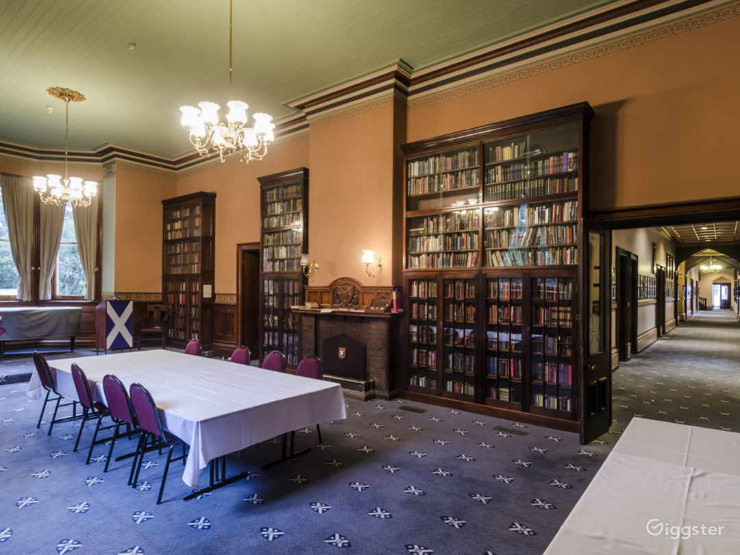 Reading Room with Fireplace and Portraiture View Photo 1