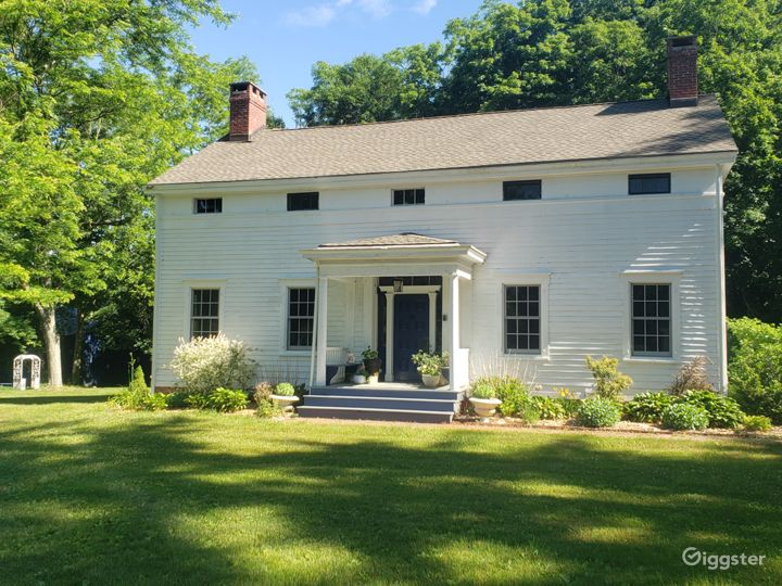Our 1840s eyebrow colonial with brick walkway and serene garden.