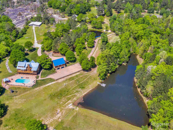 Overhead drone view of Gray Hillcrest Estates. 2 Acre lake, a small pond, cascading waterfalls, on granite rock shoals, a wooded trail.