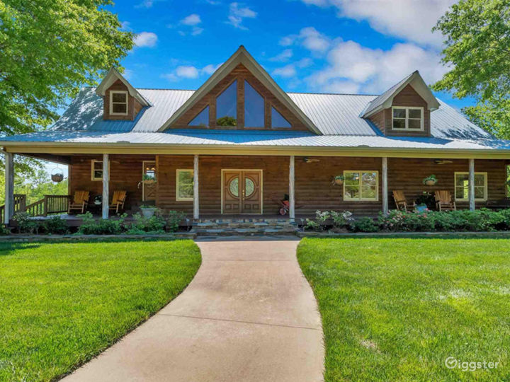 Stunning custom built log cabin home with a long rocking chair front porch
