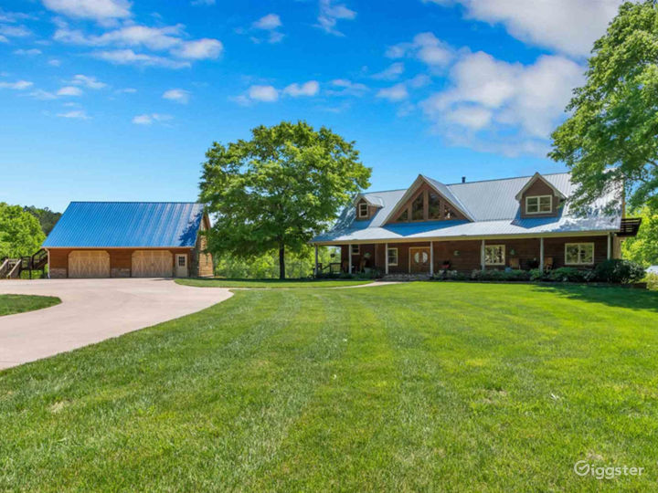 Gorgeous log cabin home with a 4 car detached garage that sits on 19 acres.