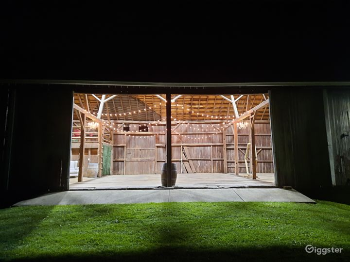 Barn has string lights and chandeliers for whimsical feel but also has LED lights to provide extra lighting