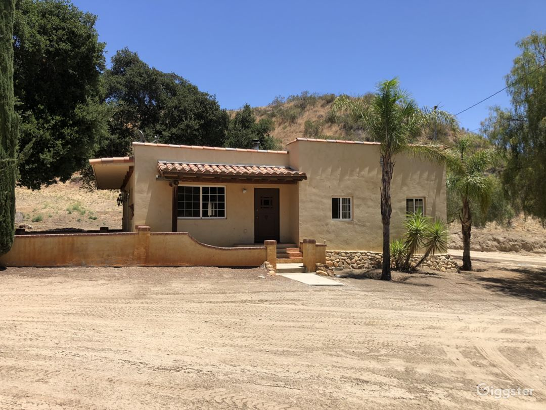 The home was built in 1913 and is situated 2,000 feet from the main entrance and features three bedrooms, 2 baths a wood burning fireplace in a rustic Santa Fe style.