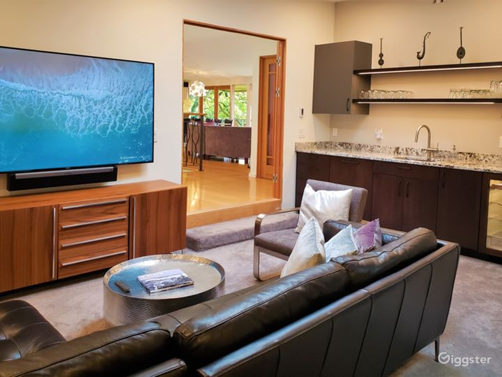"The sunken media lounge, off the great room, has a 75"" TV with 5.1 surround-sound and a 10-foot wet bar with a Sub-Zero beverage refrigerator and dishwasher."
