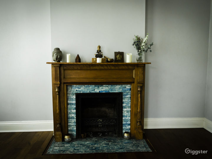 There are two fireplaces that create a warm space and look great with candles lit in them.
