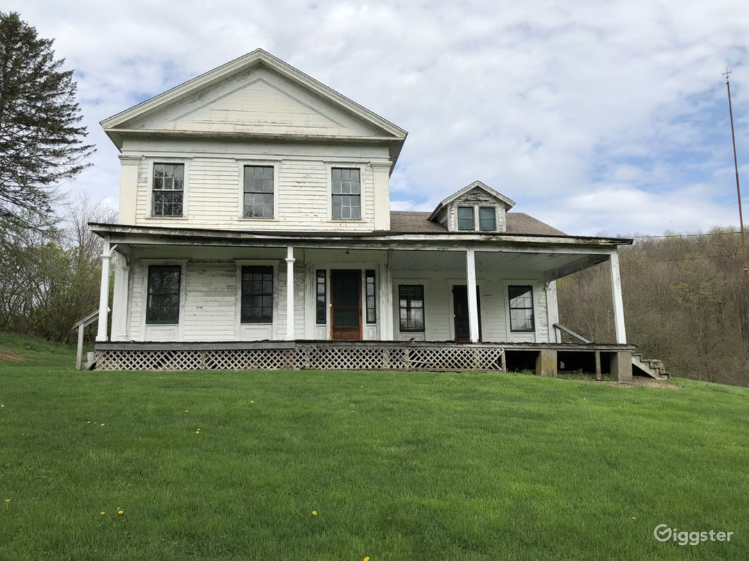 1850's Greek Revival house with historic charm, front porch. Iconic Upstate NY architecture.