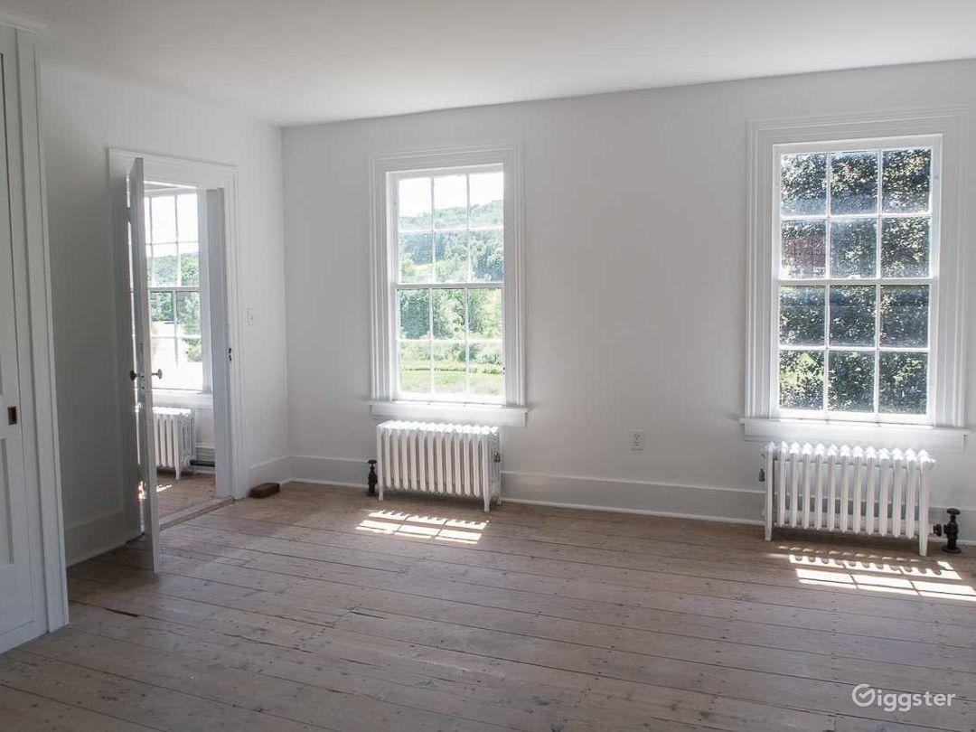 original wide-board flooring, and sash windows