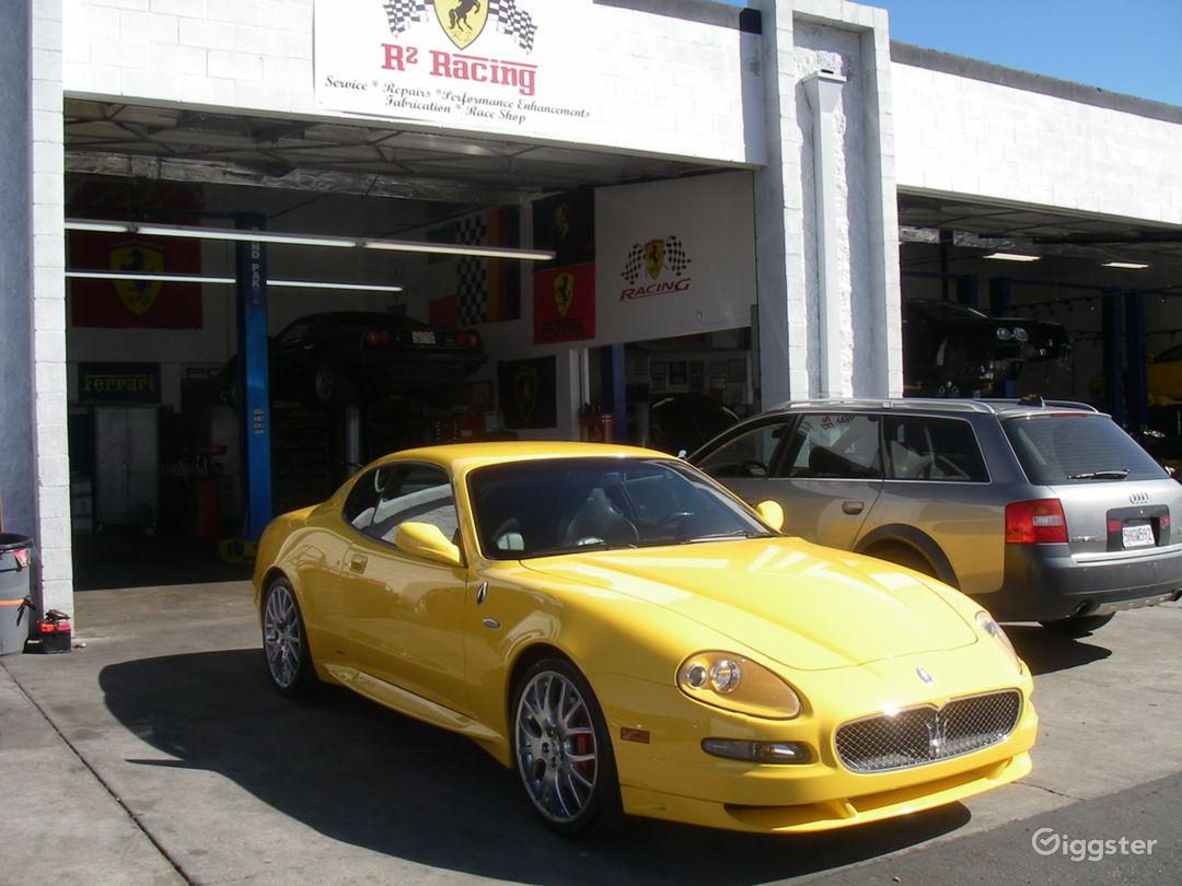 exotic car shop 4 bays, always loaded with Ferraris, Porsches, Maseratis, Lamborghinis