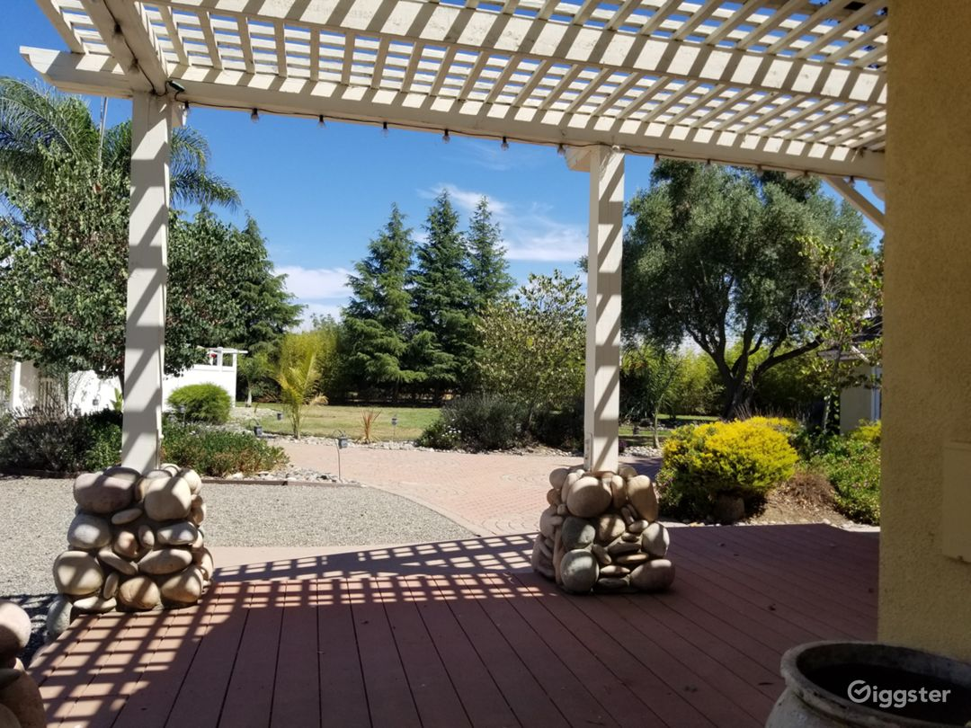 Private deck and pergola outside Vineyard Villa looks out on zen garden, vineyard and mountain views.