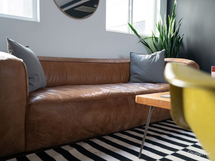 Leather Sofa w/ Eames Chairs