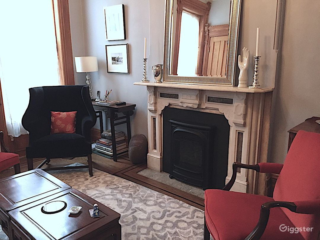 Parlor with marble mantle and working gas fireplace