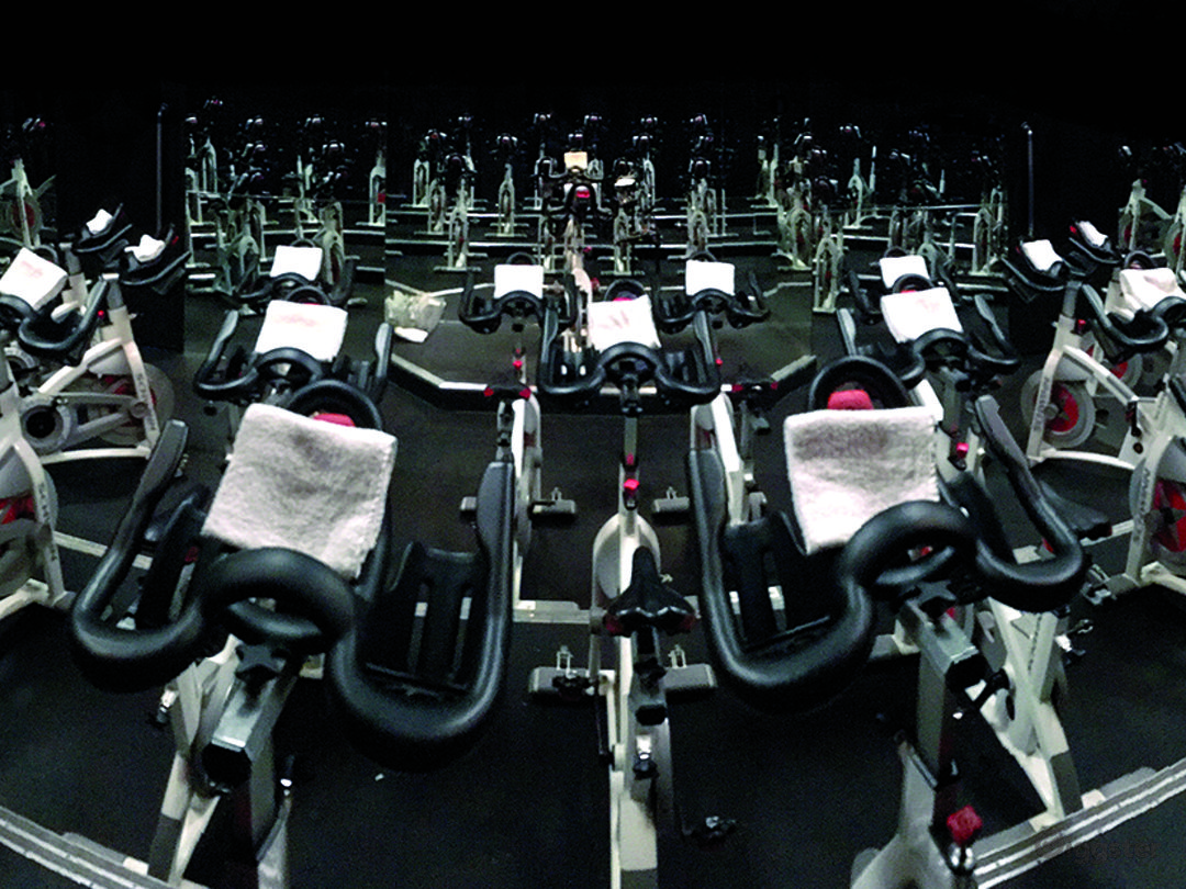 Indoor Cycling Studio with 3 levels, 42 bikes, studio quality sound system, wireless microphone system, instructor podium, lighting and DJ booth
