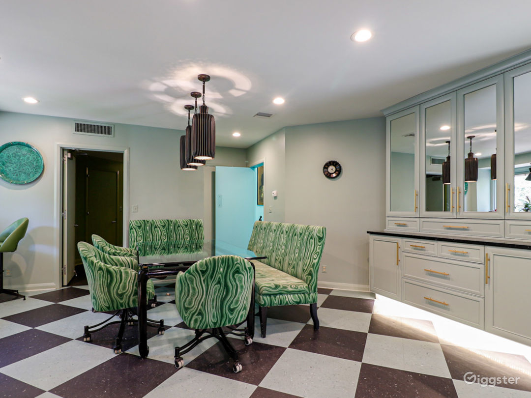 Turquoise and emerald period kitchen with harlequin floor, colored appliances, faux malachite backsplash as upholstery.