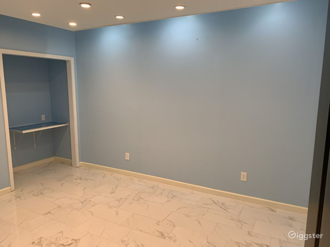 Basement/ 3rd room . Dimmer lights with marble floor.