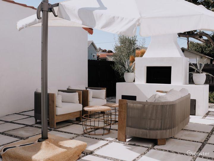 Backyard lounge / fireplace area - shown as provided.