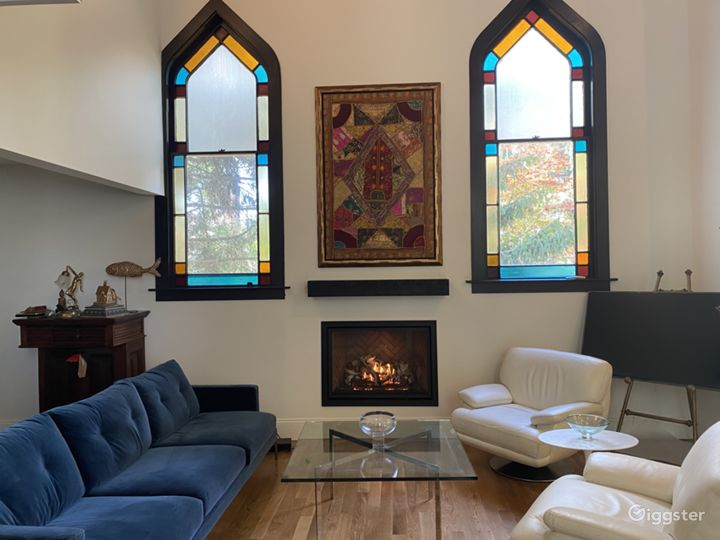 Living area with stained glass windows facing West, Modern gas fireplace flush to wall with remote.